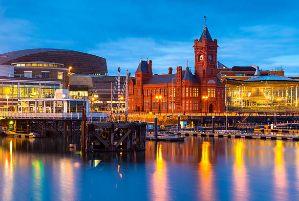 Cardiff Bay, Wales Cardiff Bay at dusk, the Pierhead building (1897) and National Assembly for Wales can be seen over the water. wales stock pictures, royalty-free photos & images