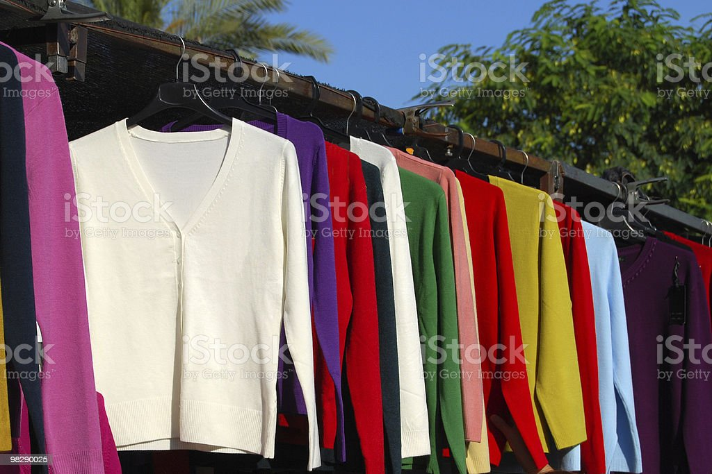 Cardigans on market stall royalty-free stock photo