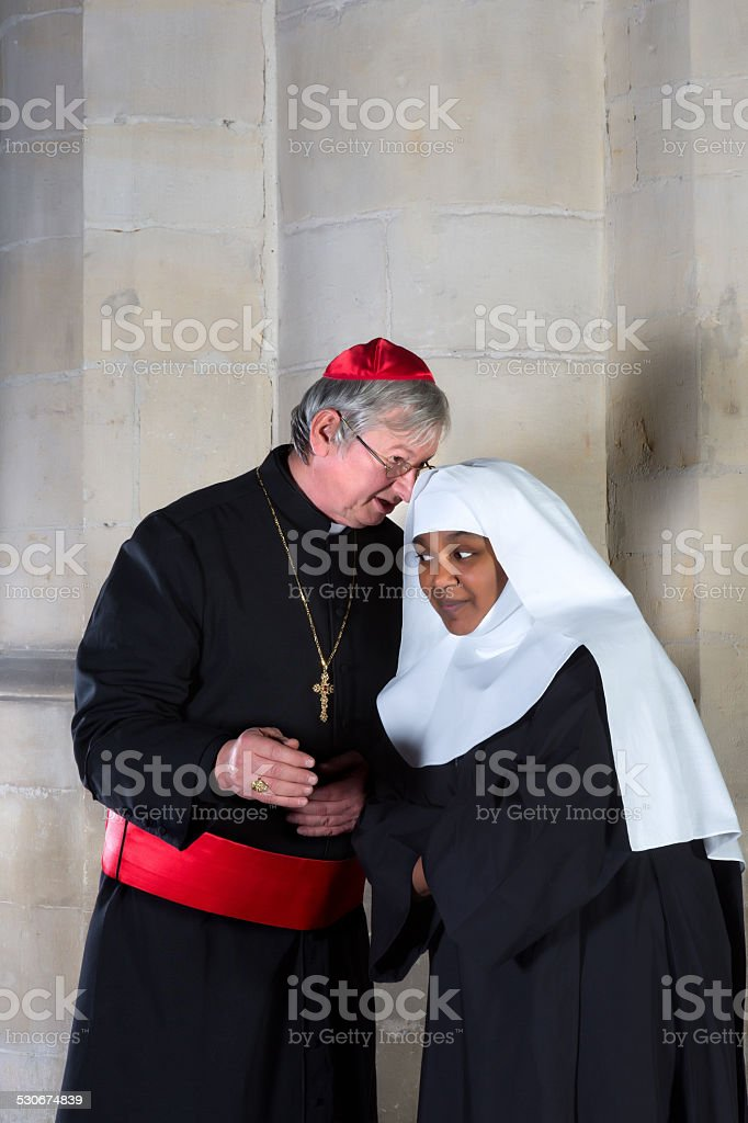 Cardinal and nun stock photo