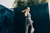 istock Cardio Training: Fit Blonde Woman Doing a Dynamic Exercise Outdoors 1216432660
