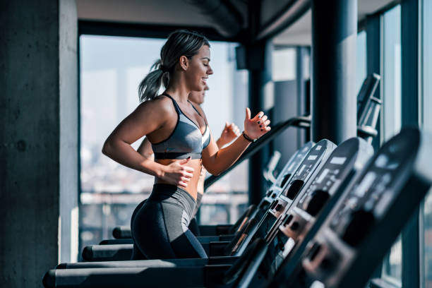 Cardio workout on a treadmill. stock photo
