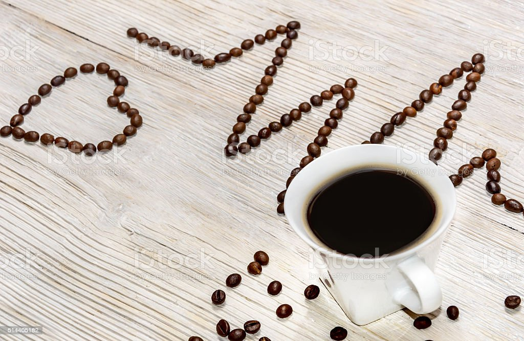 cardiogram laid out coffee beans with a cup of coffee stock photo