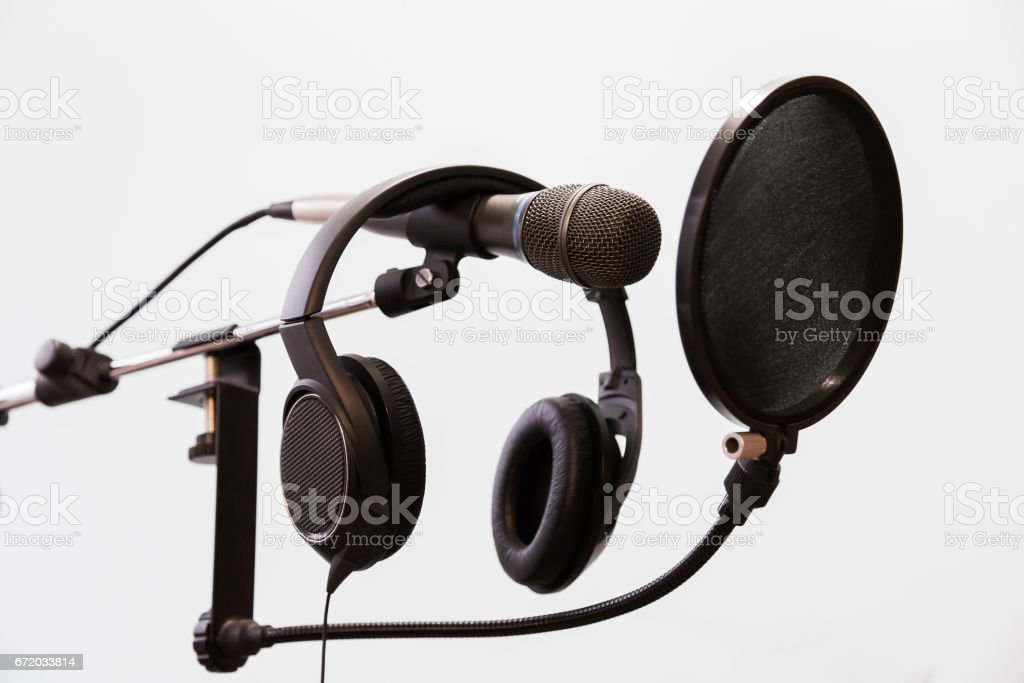 Cardioid condenser microphone, headphones and pop filter on a gray background. Home recording Studio stock photo
