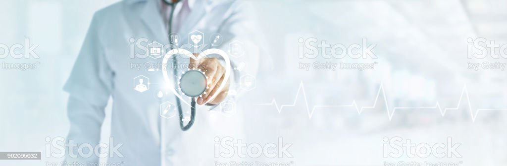 Cardiologist doctor with stethoscope in hand toching medical icon network connection on modern virtual screen networking inerface, medical technology and patient concept, blank text stock photo
