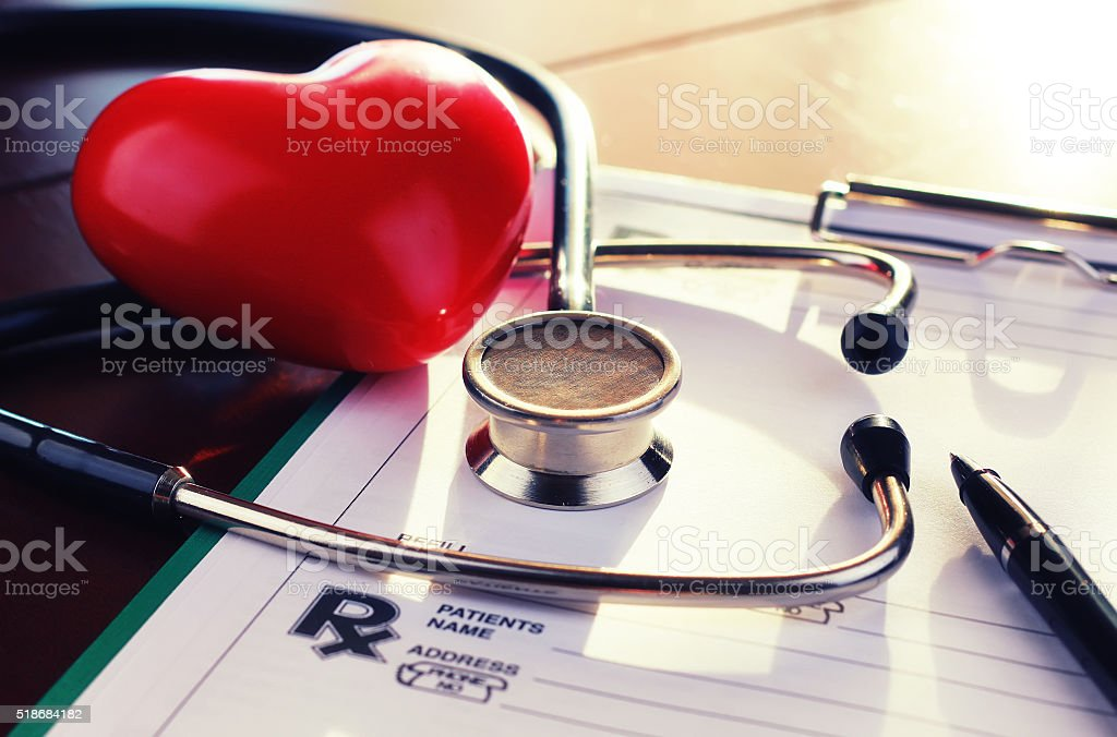 cardiologist stethoscope paper insurance stock photo