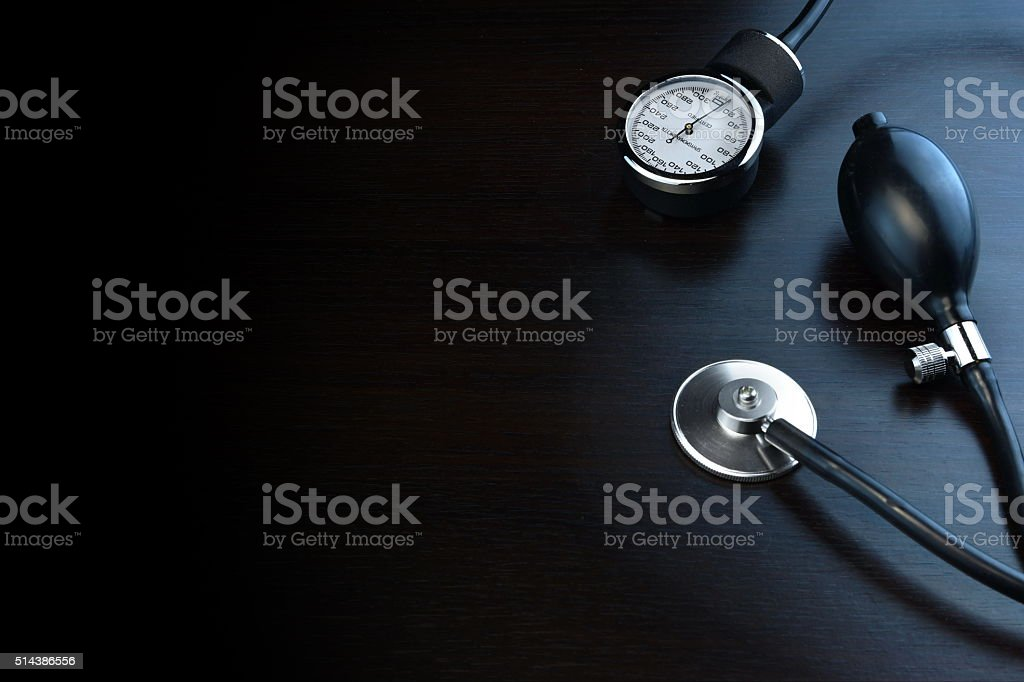 Cardiology Medical Equipment On Black Wooden Background In Back stock photo
