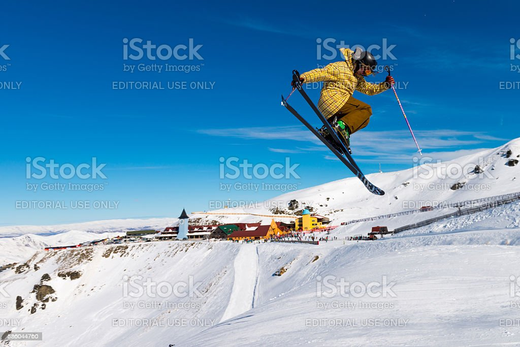 Cardrona Mountain Resort with freestyle skier stock photo