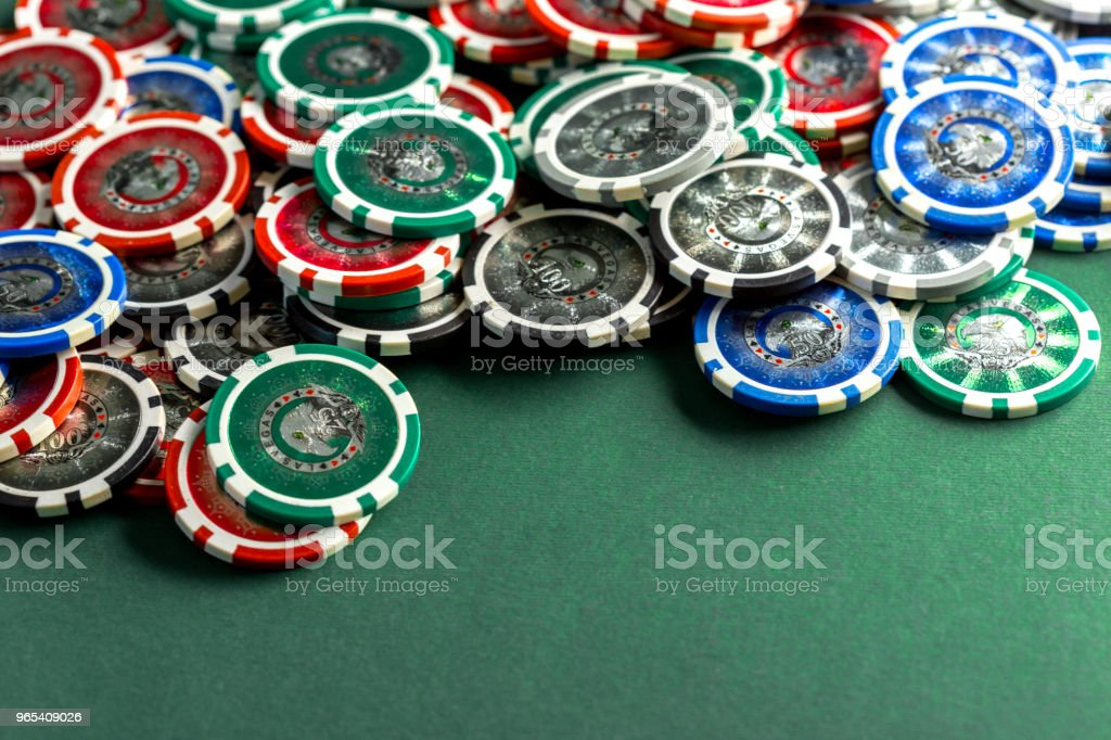 Cards and chips for poker on green table royalty-free stock photo