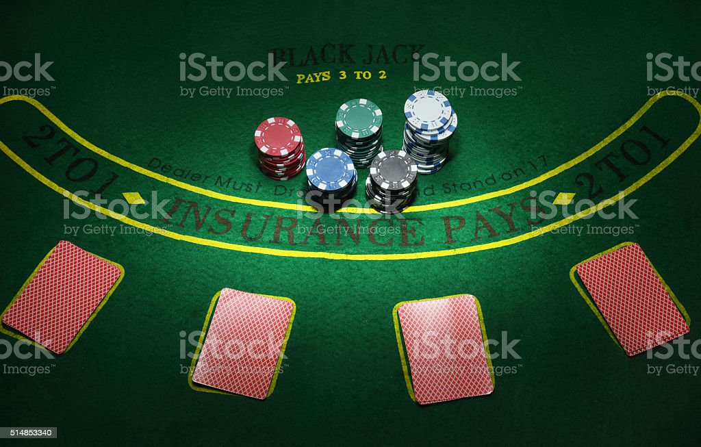 Cards and chips for poker on green table, top view stock photo