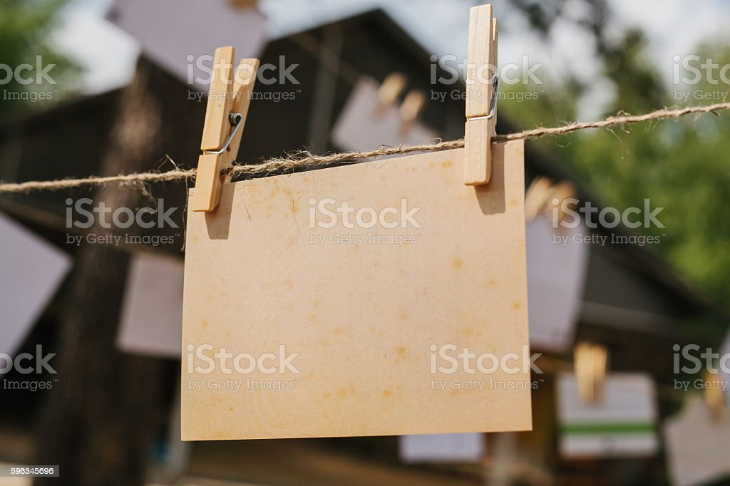 Cards hang on a rope. Conceptual background. The festival outdoors. royalty-free stock photo
