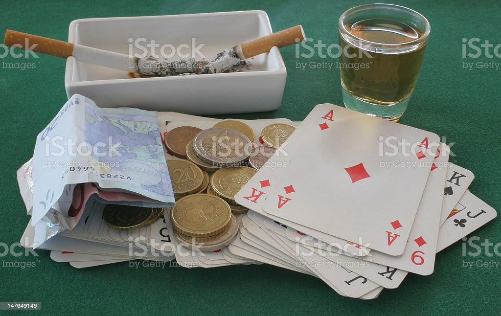 Cards, Money, Whiskey and Cigarettes royalty-free stock photo