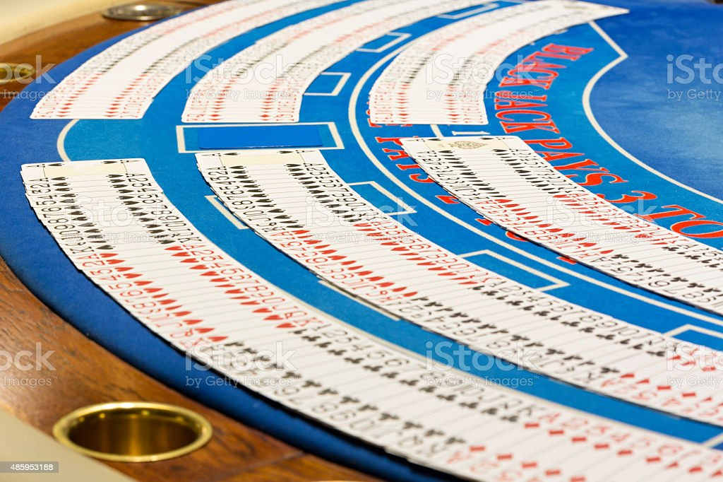 Cards on gambling table at the casino stock photo
