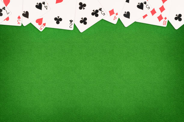 Cards on green felt casino table background Cards on green felt casino table background. Template with copy space in center playing card stock pictures, royalty-free photos & images