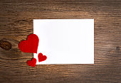 cards on the wooden background, A card decorated with hearts.