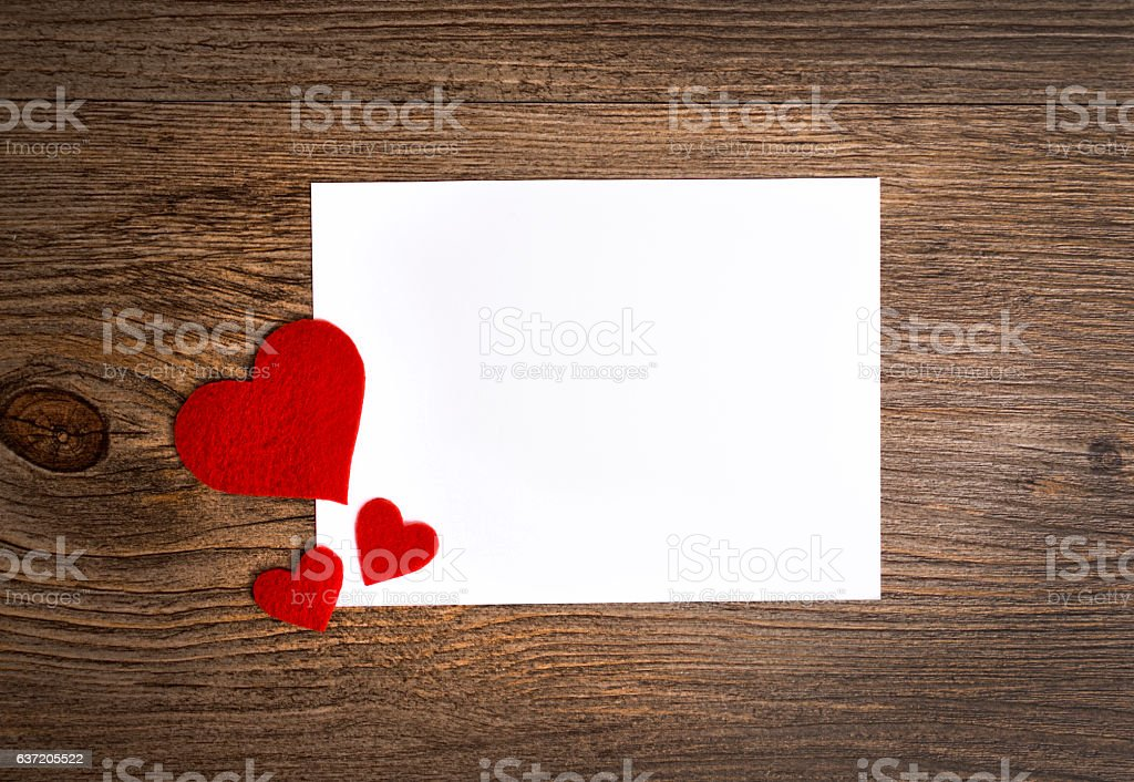 cards on the wooden background, A card decorated with hearts. stock photo