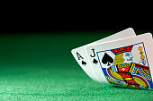 Black jack on a poker table against a black background and selective focus.