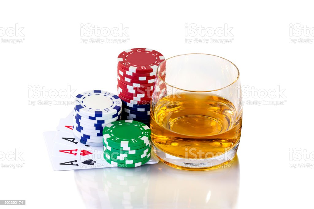 Cards to poker and colorful chips with glass of whiskey stock photo