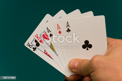 istock cards with hand 06 poker full house 139701954