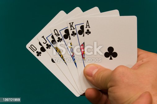istock cards with hand 09 poker royal flush 139701959