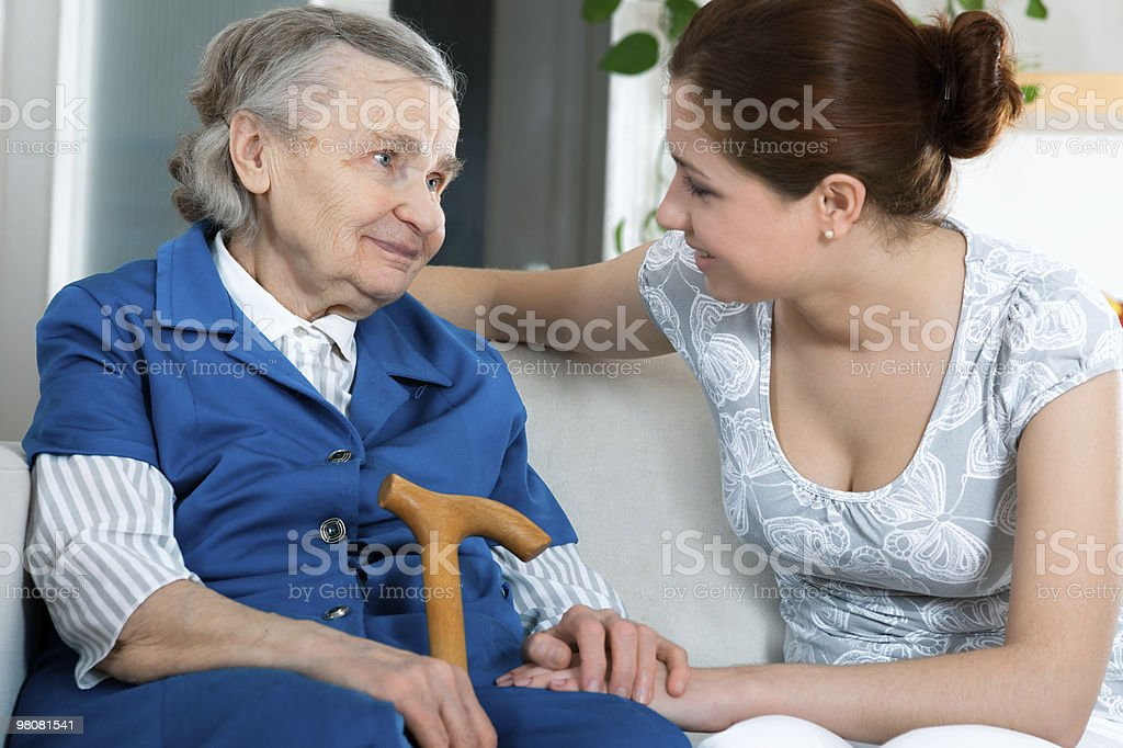 Care and passion between old grandmother and a lady royalty-free stock photo