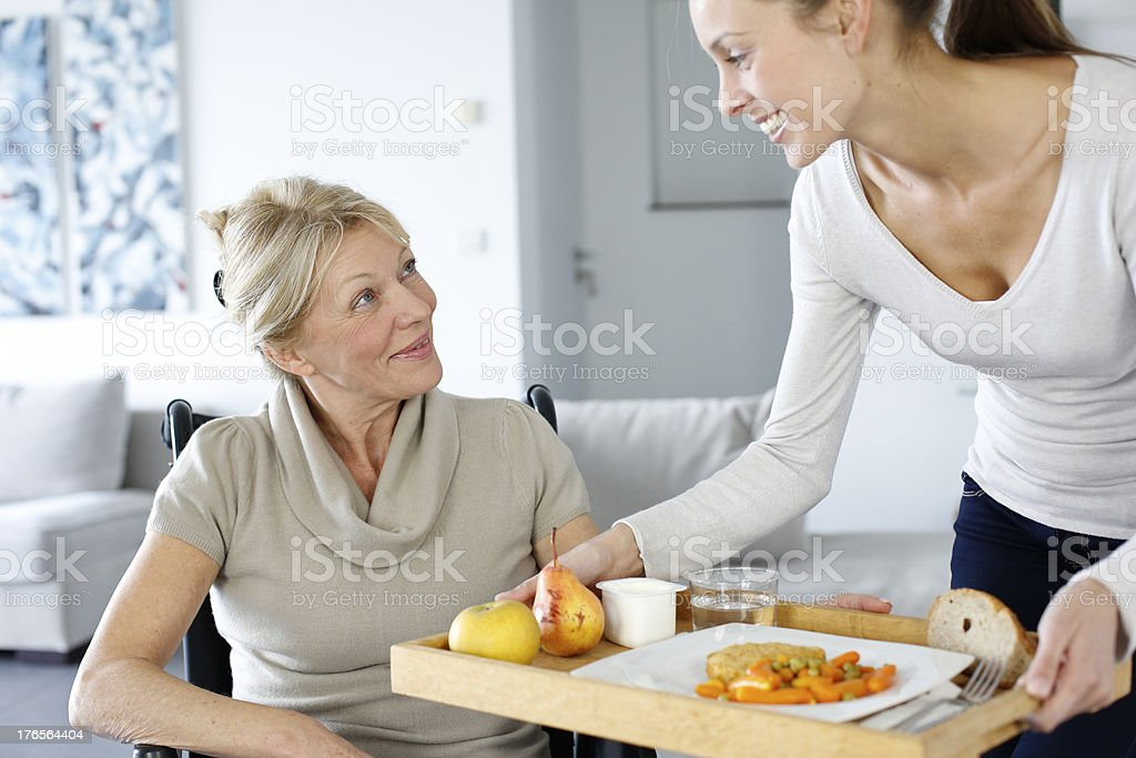 Care assistant and old lady living together in same house royalty-free stock photo