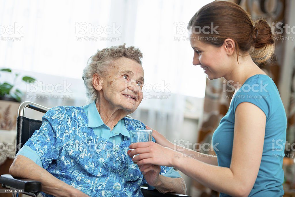 Care assistant helping an elderly patient royalty-free stock photo
