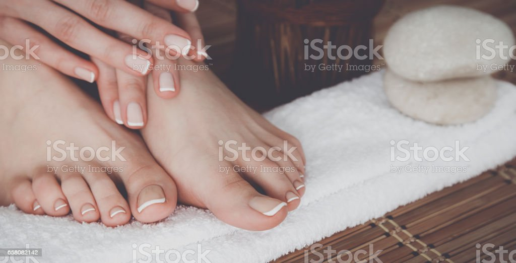 Care for beautiful woman legs on the floor royalty-free stock photo