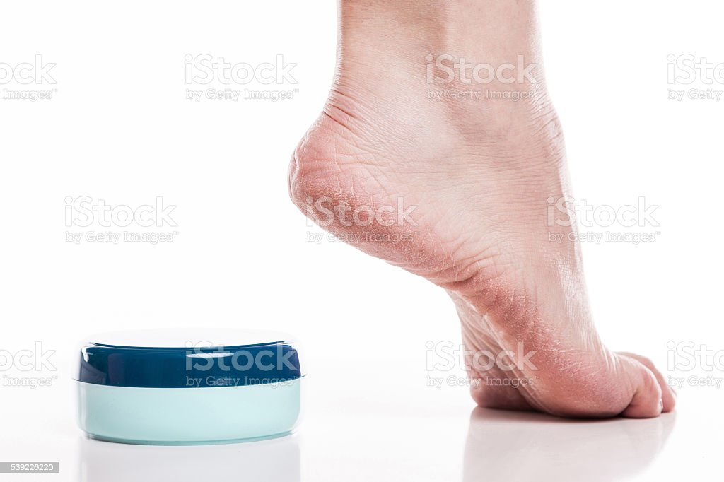care for dry skin  feet and heels with creams stock photo