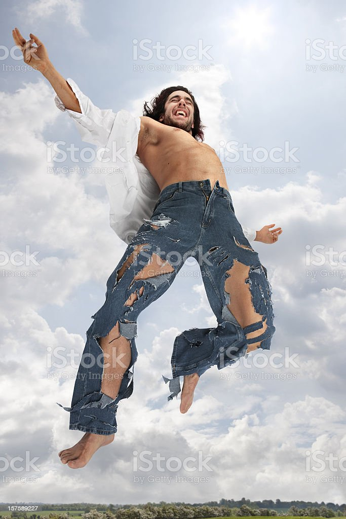 care free man wearing torn jeans enjoying freedom royalty-free stock photo