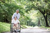 Senior couple in wheelchair.