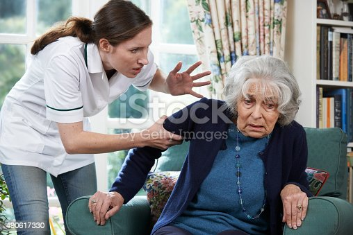istock Care Worker Mistreating Senior Woman At Home 490617330