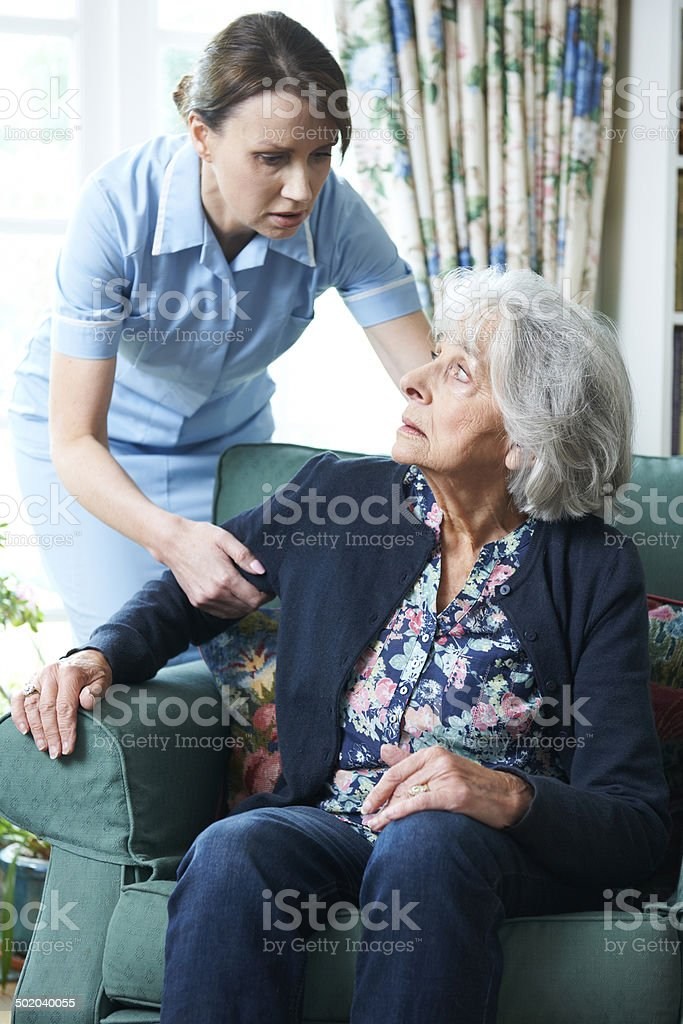 Care Worker Mistreating Senior Woman stock photo
