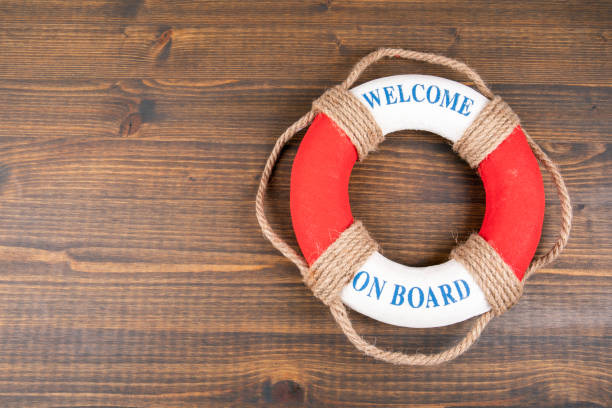 WELCOME ON BOARD. Career, education and teamwork concept. Lifebuoy with text stock photo