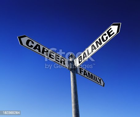 182362845 istock photo Career family balance with white and black street signs 182365264