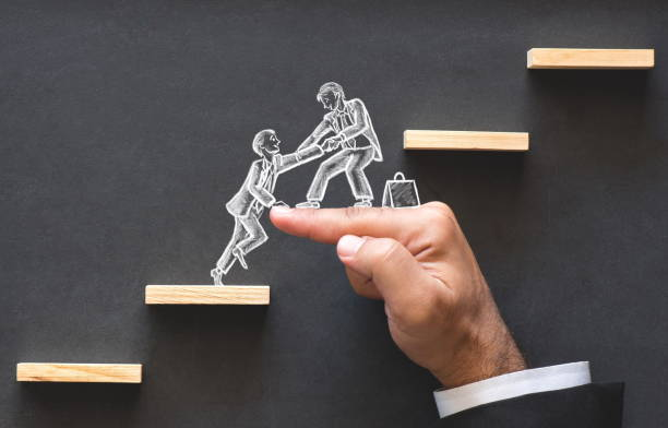 career planning and business challenge concept with hand drawn chalk illustrations on blackboard - a helping hand stock pictures, royalty-free photos & images