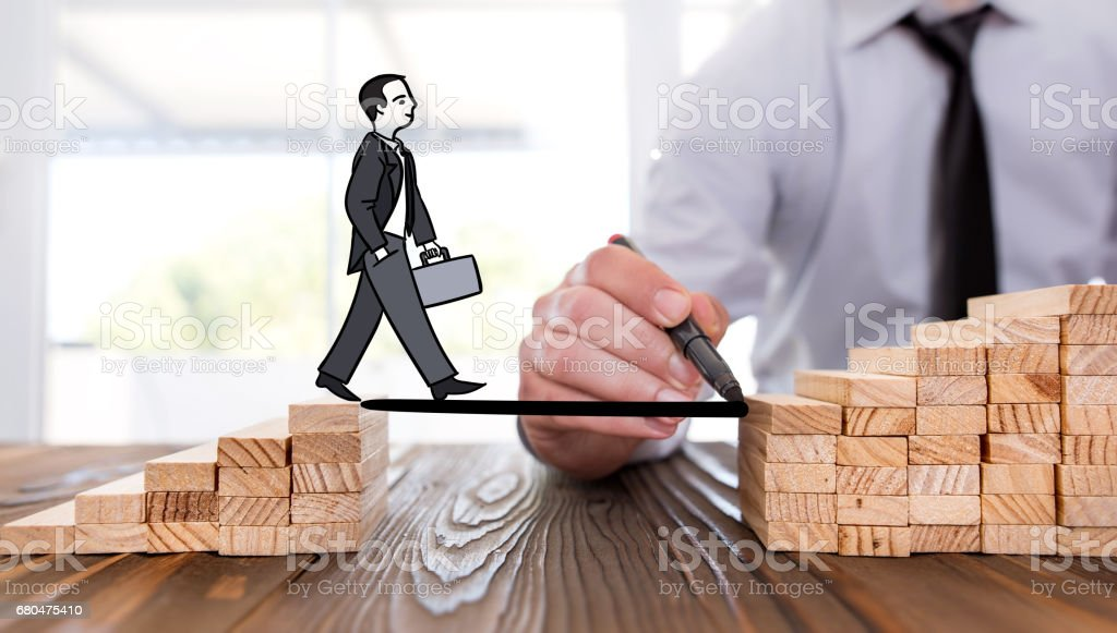 Career Planning Concept. Businessman Getting Help Building Bridges To Success. stock photo