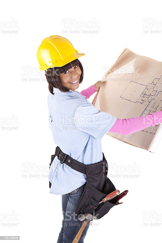 Careers pre-teen as construction worker architecture drawings in hands royalty-free stock photo