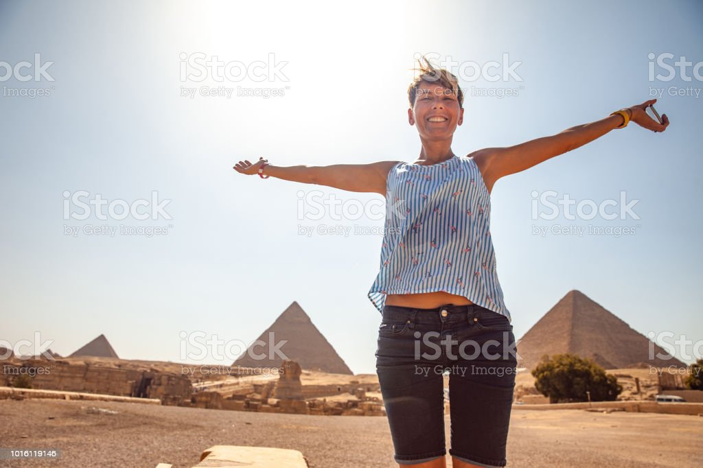 Carefree Adult Woman Tourist With Pyramids of Giza stock photo