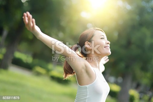 istock Carefree and free woman 523311875