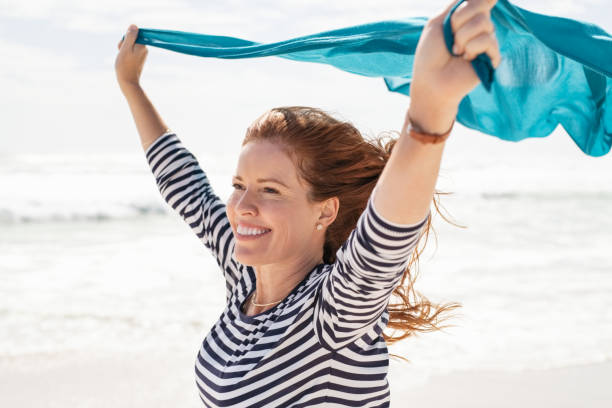 Carefree and freedom mature woman stock photo