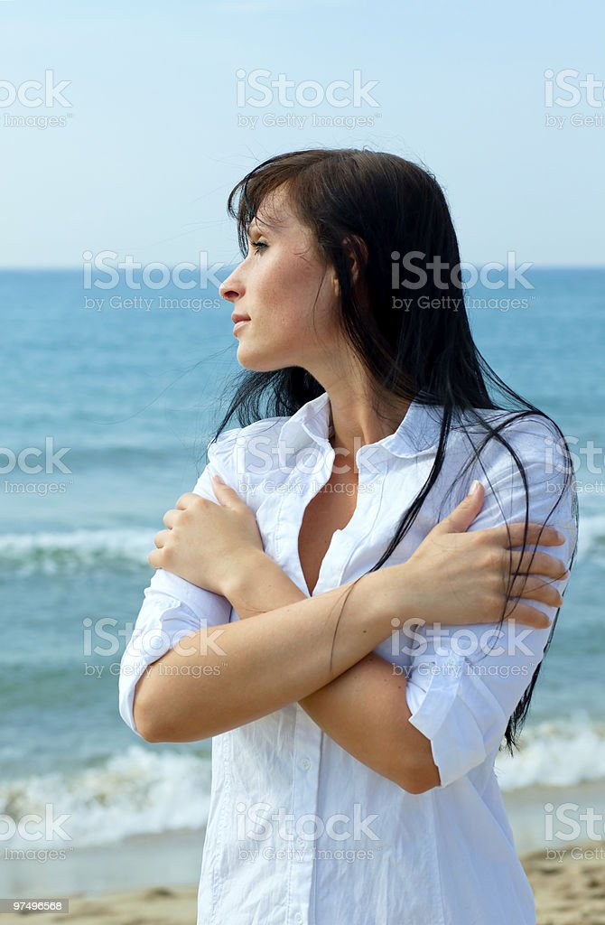 carefree arms around woman on the beach royalty-free stock photo