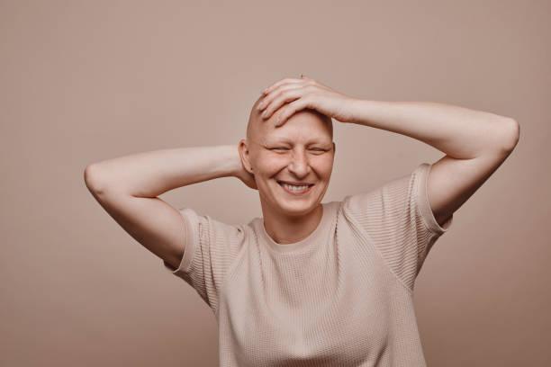 Carefree Bald Woman in Studio stock photo