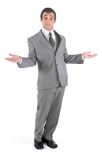 Carefree businessman shrugging Carefree businessman shrugging shrugging stock pictures, royalty-free photos & images