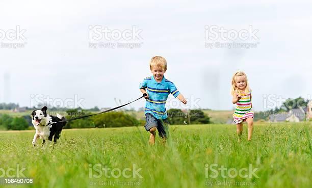 Carefree children happy with pet dog picture id156450708?b=1&k=6&m=156450708&s=612x612&h=5b4y4dvkchpbjpu2mk6ervr7cwcbzhjgd503yjmgrbs=