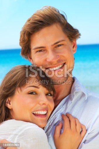 135359671 istock photo Carefree couple on the beach 144331093