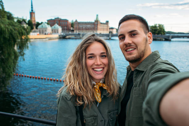 Carefree couple visiting Sweden stock photo