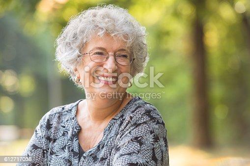 istock Carefree elderly woman 612717036