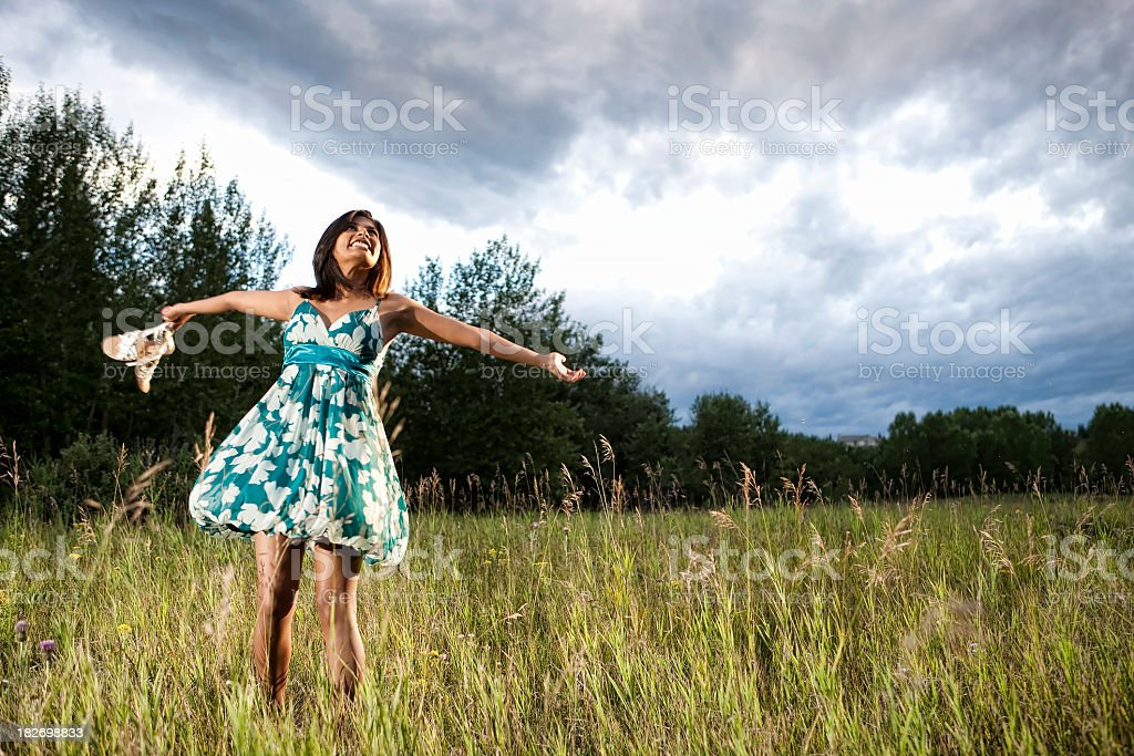 Carefree Girl Twirling in Field royalty-free stock photo