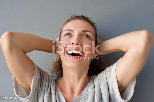 istock Carefree happy woman laughing with hands in hair 469124302