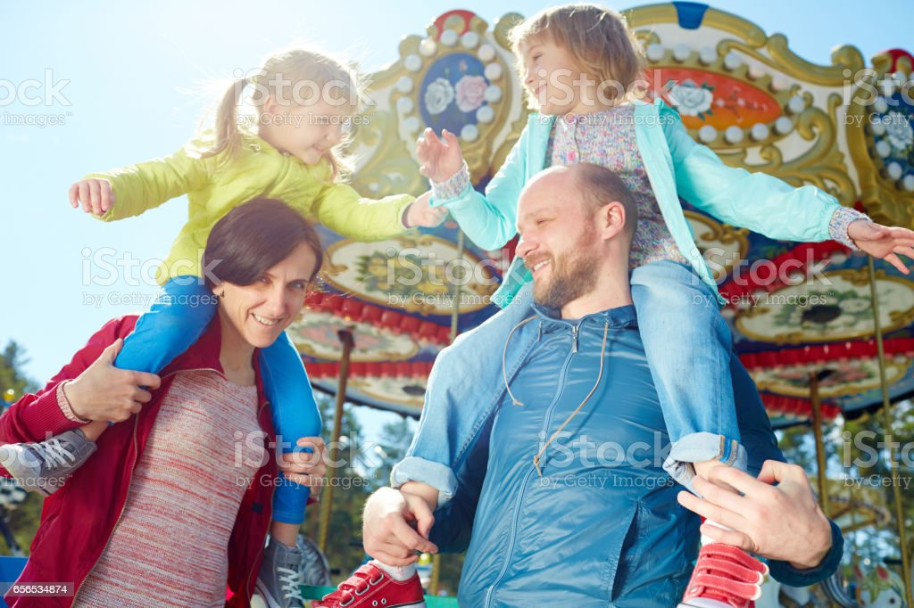 Carefree little girls relaxing in park stock photo